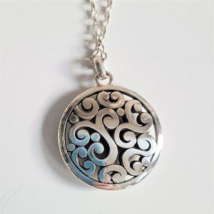 Large round pendant with long chain.